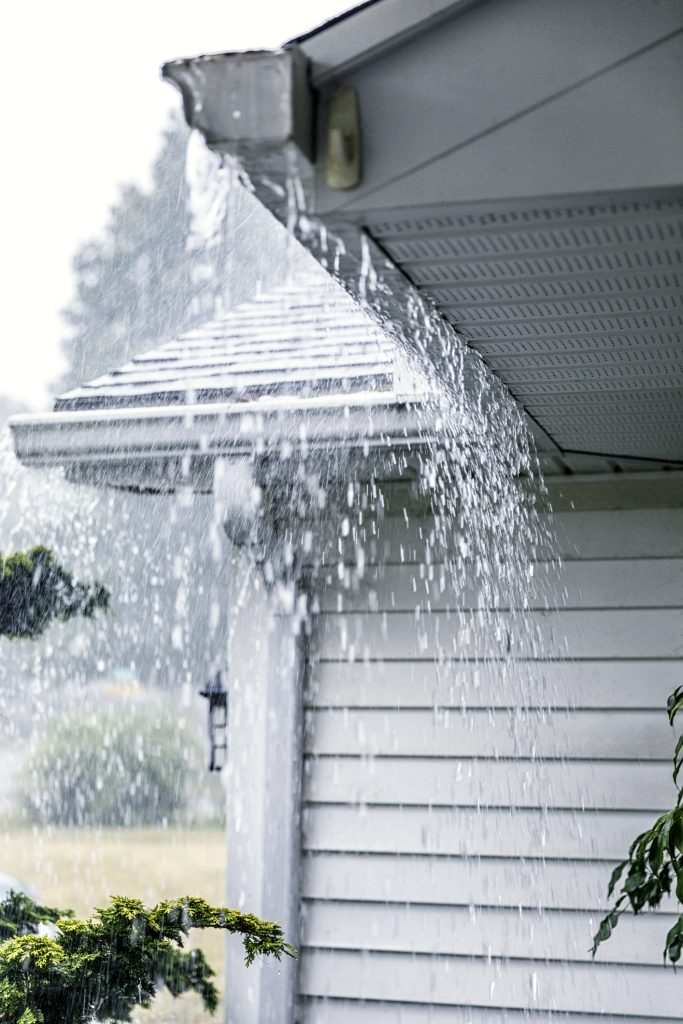 Water Overflowing Roof Gutters